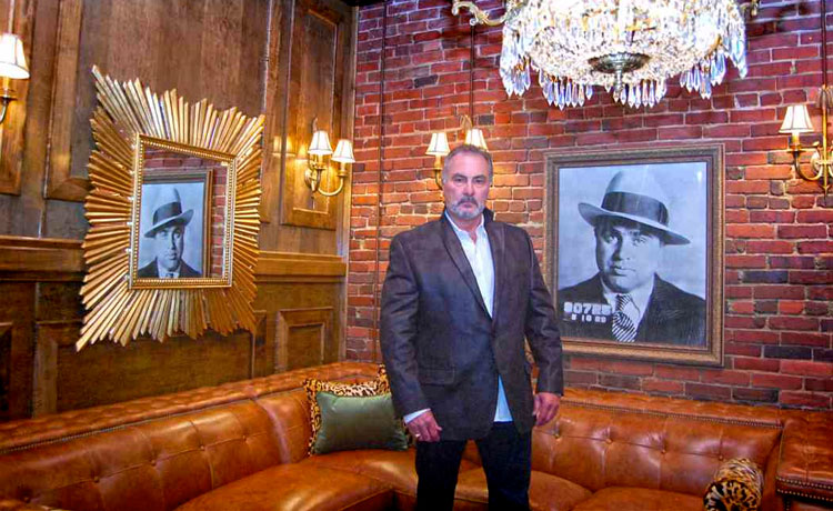 Businessman transform loft into speakeasy